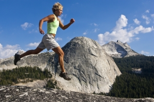 Woman Trail Runner Bounding